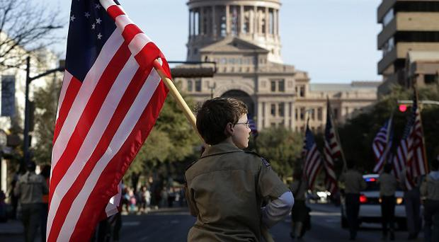 The US President praised the Boy Scouts of America as 'a great institution' that promoted young people (AP/Eric Gay)