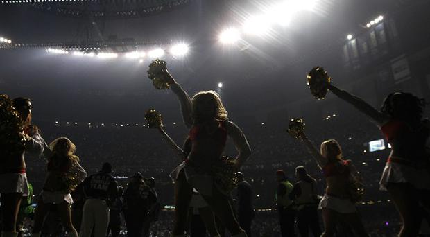 San Francisco 49ers cheerleaders perform during a power cut during the second half of the Super Bowl in New Orleans (AP)
