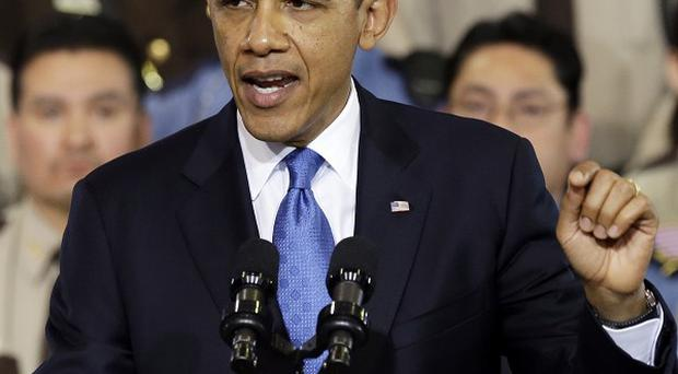 President Barack Obama has signed a bill raising the US government's borrowing limit (AP)