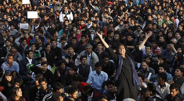 Crowds protesting in New Delhi over the treatment of women (AP)