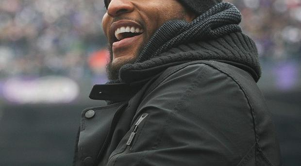 Baltimore Ravens' Ray Lewis rubs the Lombardi Trophy during a celebration of their Super Bowl win (AP/The News-Journal)