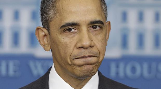 US President Barack Obama is asking Congress to delay automatic across-the-board cuts earmarked for March 1 (AP)