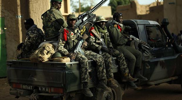 Malian soldiers patrol the streets of Gao (AP)