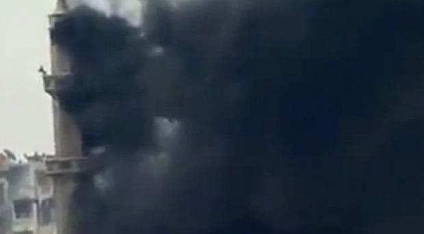 Smoke and fire billowing from an explosion in Damascus (AP)