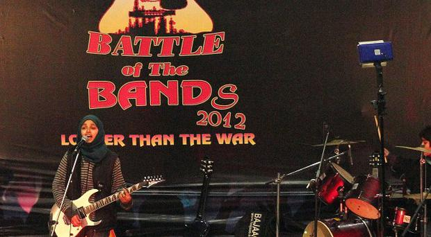 Pragaash, or First Light, perform at the annual Battle of the Bands in Srinagar, India (AP)