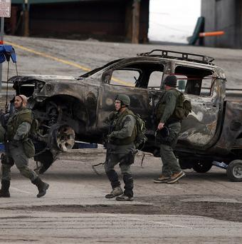 A burned-out pickup truck belonging to ex-Los Angeles police officer Christopher Dorner was found in Big Bear, California (AP)
