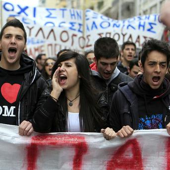 Students march during a rally against austerity measures in the northern Greek port city of Thessaloniki (AP)
