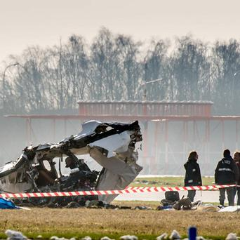 Police inspect the wreckage of a crashed Cessna plane at Charleroi airport, Belgium (AP)