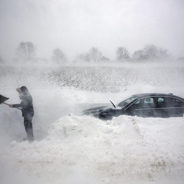 A boy has died of carbon monoxide poisoning amid severe weather in Boston (AP)