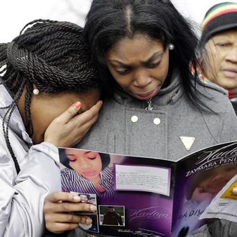 Danyia Bell and Artureana Terrell read an order of service for the funeral of Hadiya Pendleton (AP)