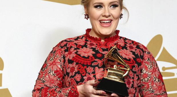 Adele with the award for best pop solo performance for Set Fire to the Rain at the 55th annual Grammy Awards (Invision/AP)