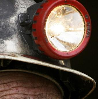 Rescue teams in Russia are searching for eight missing men following an explosion at a coal mine