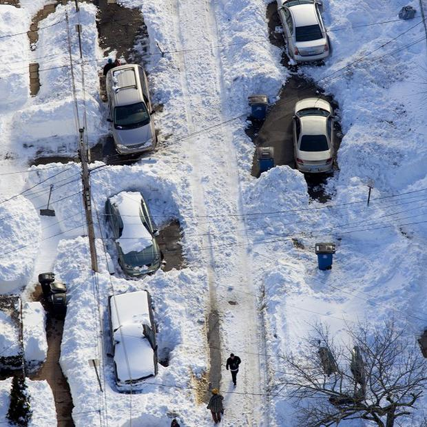 People try to dig out from a blizzard near New Haven, Connecticut (AP)
