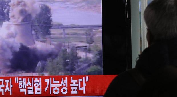 A South Korean man watches TV news showing footage of the demolition of the cooling tower of the Yongbyon nuclear complex (AP)