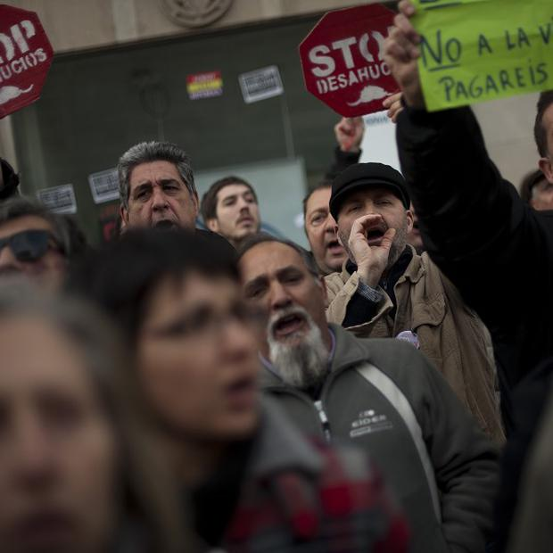 Spanish protesters calling for a change to mortgage laws which lead to evictions (AP)