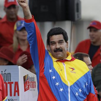 Venezuela's Vice President Nicolas Maduro waves to supporters during a demonstration (AP)