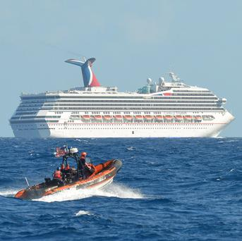 The Carnival Triumph cruise ship is being towed back to the US (AP)