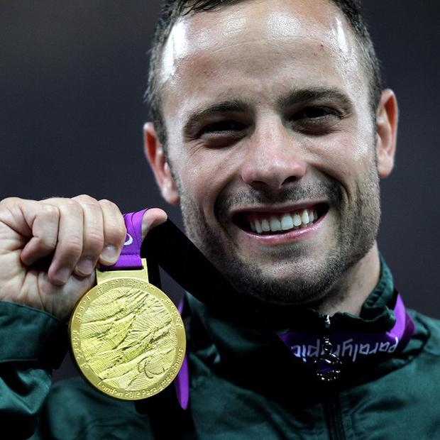 South Africa's Oscar Pistorius celebrates with his gold medal after winning the Men's 400m T44 final at the Olympic Stadium, London