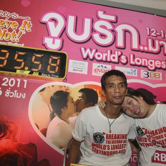 Celebrating their world record longest kiss, are Ekkachaii Tiranarat, left, and Laksana Tiranarat (AP)