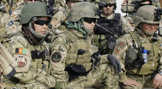 Female members of Afghan special forces, first row, pose after practicing a house raid on the outskirts of Kabul (AP)