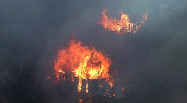 Houses burn during a fire in Chile (AP)