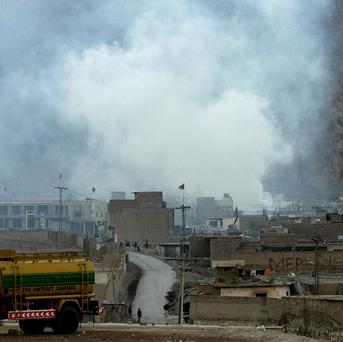 Smoke rises from the site of a bomb blast at a market in Quetta, Pakistan (AP)