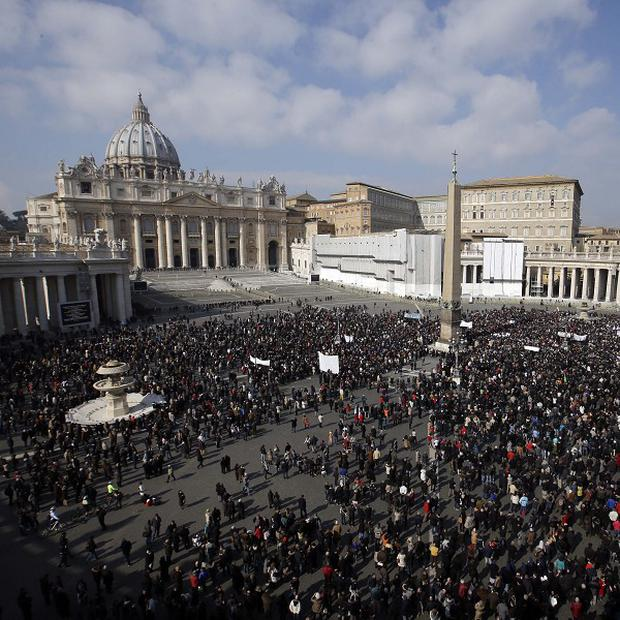 Faithful gather to listen to pope Benedict XVI's Angelus prayer in St Peter's square at the Vatican (AP)