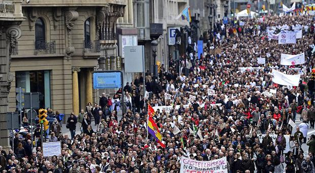 Health workers protest against the austerity measures in Barcelona, Spain (AP)