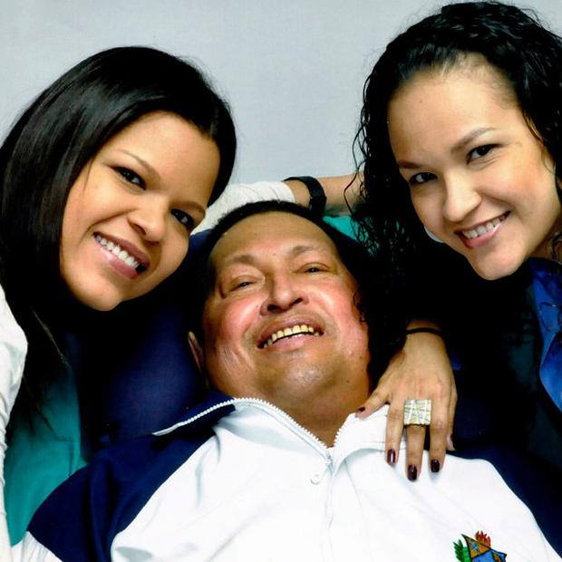 Venezuela's president Hugo Chavez with daughters, Maria Gabriela and Rosa Virginia (AP)