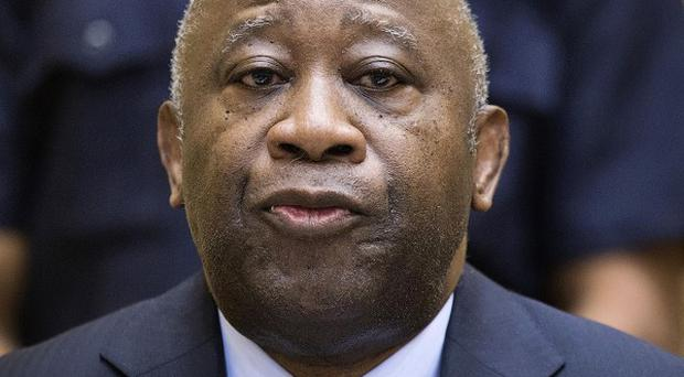 Former Ivory Coast president Laurent Gbagbo attends a hearing at the International Criminal Court in The Hague (AP)