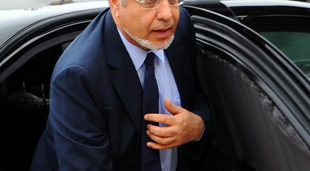 Tunisian Prime Minister Hamadi Jebali arrives for a meeting with representatives of all Tunisian political parties (AP)