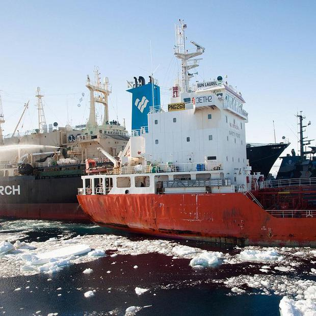 Japanese whaling vessel Nisshin Maru, left, collides with the fuel tanker Sun Laurel in waters near Antarctica (Sea Shepherd Australia, AP)