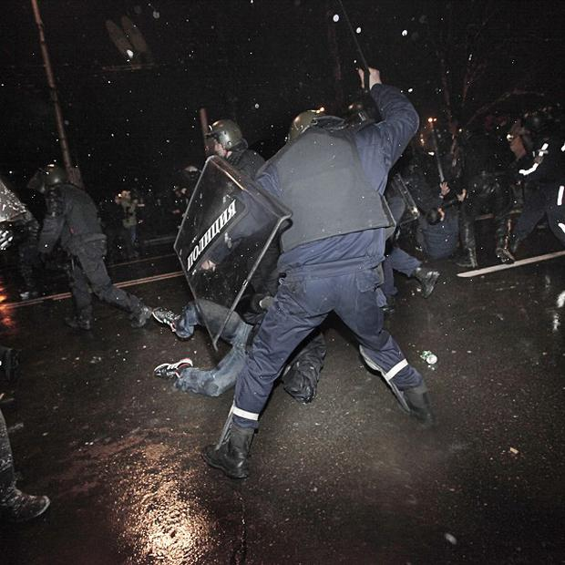 Protesters are beaten by riot police during in Sofia (AP)
