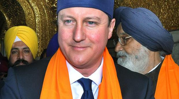 David Cameron visits the Golden Temple, Sikh's holiest shrine in Amritsar, India (AP/Prabhjot Gill)