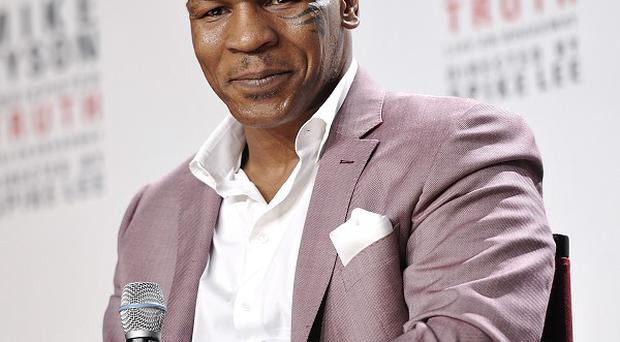 Mike Tyson has broadened his career in recent years, including leading a one-man autobiographical show, Undisputed Truth (Evan Agostini/Invision/AP)