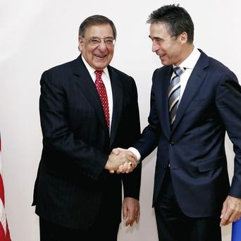 US Secretary of Defence Leon Panetta, left, with Nato Secretary General Anders Fogh Rasmussen, in Brussels (AP)