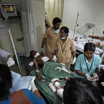 An injured person is attended to at a hospital after deadly blasts in Hyderabad. (AP)