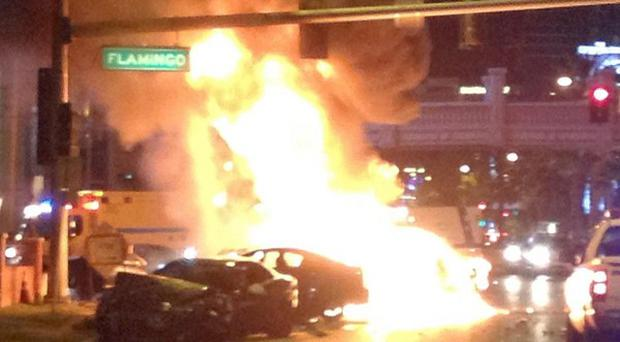 Smoke and flames billow from a burning vehicle following a shooting and multi-car accident on the Las Vegas Strip in Las Vegas (AP/Erik Lackey)