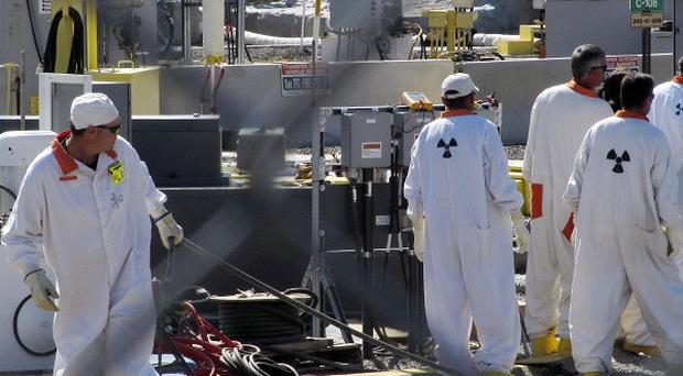 Workers at the Hanford nuclear reservation work where highly radioactive waste is stored underground (AP)