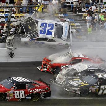 Kyle Larson (32) goes airborne into the catch fence at Daytona International Speedway, Florida (AP/John Raoux)