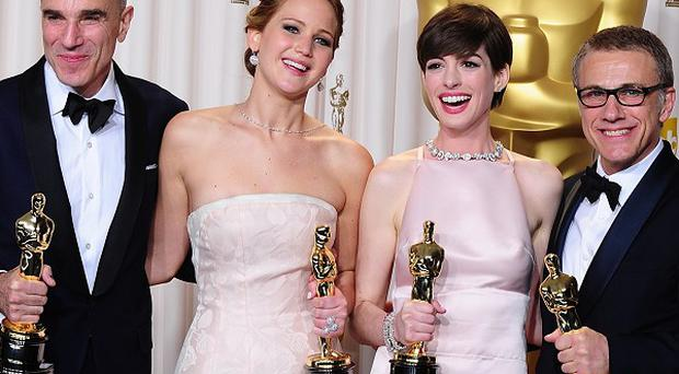 Daniel Day-Lewis, Jennifer Lawrence, Anne Hathaway and Christoph Waltz hold their Oscars during the 85th Academy Awards in Los Angeles
