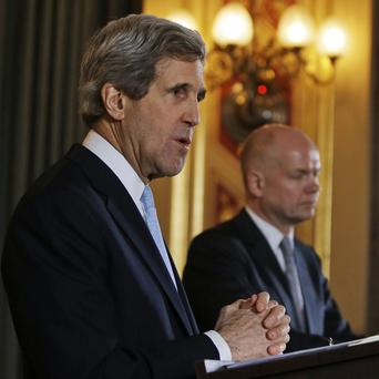 Foreign Secretary William Hague, back, and US Secretary of State John Kerry following their meeting in central London