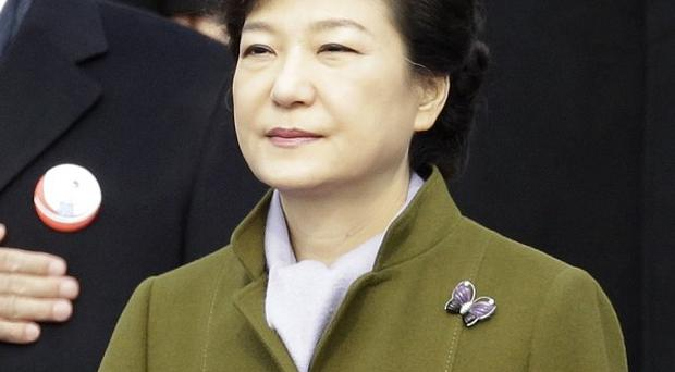 President Park Geun-hye salutes the national flag in Seoul, South Korea (AP Photo/Lee Jin-man)