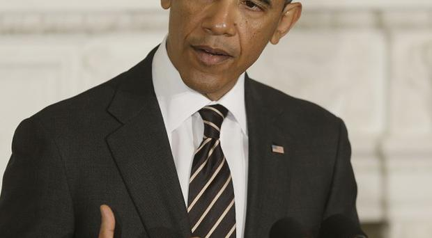 US President Barack Obama has warned that uncertainty over spending cuts 'is already having an effect'