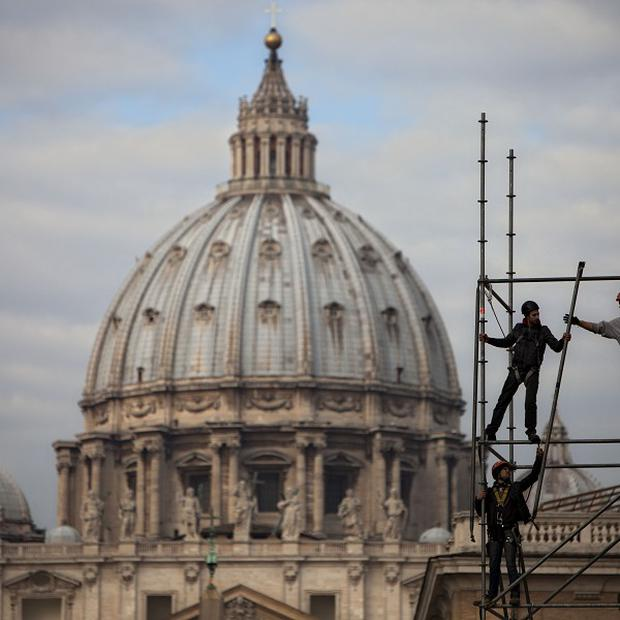 Workmen erect a media gantry for the pope's final public audience (AP)