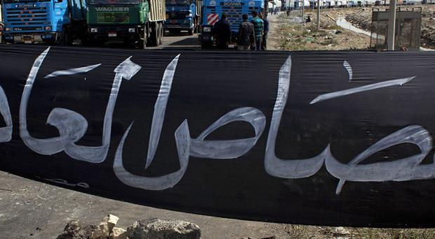 A road block set up during a general strike in Port Said, Egyp (AP)