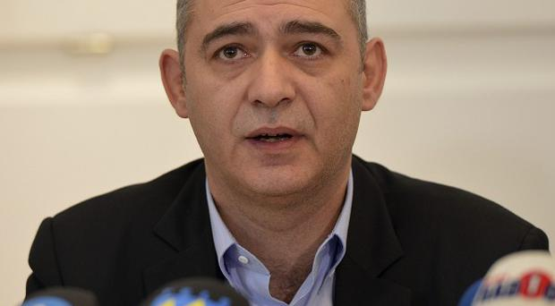 Mauro Capozzo, CEO of Swiss wood panel firma Kronospan, speaks during a press conference in Menznau (AP)
