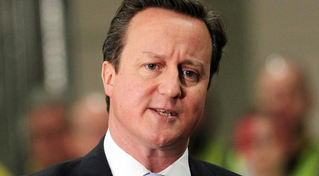 Prime Minister David Cameron is holding talks with Latvian officials during a visit to Riga
