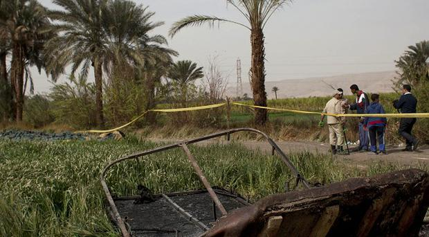 Damaged remains of the hot air balloon lie in a field near Luxor (AP)
