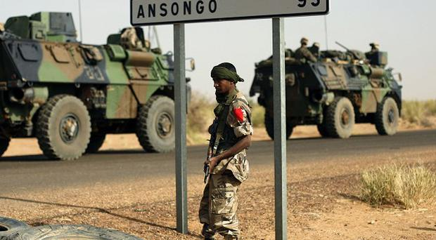 French armoured vehicles heading towards the Niger border before making a left turn north in Gao, northern Mali (AP Photo)